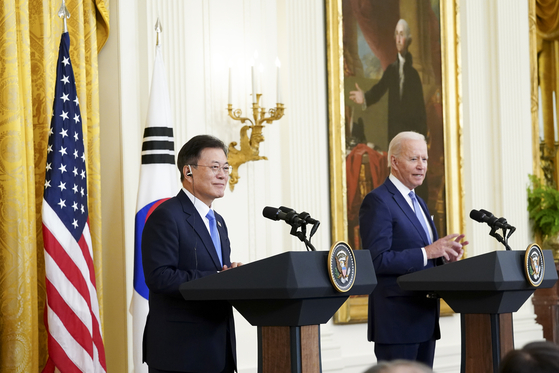 In this file photo, President Moon Jae-in, left, and U.S. President Joe Biden attend a joint press conference at the White House after their summit on May 22. [YONHAP]