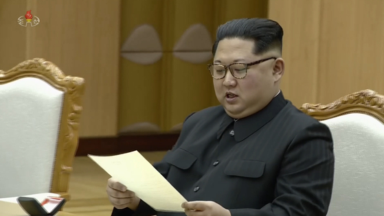 In this file photo, North Korean leader Kim Jong-un reads a letter from President Moon Jae-in on March 6, 2018. [YONHAP]