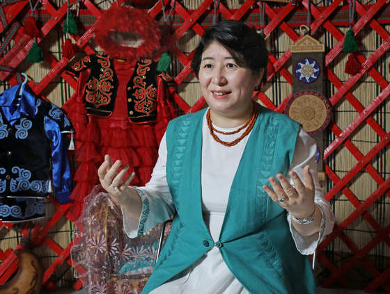 Dinara Kemelova, ambassador of the Kyrgyz Republic to Korea, speaks with the Korea JoongAng Daily at an exhibition on the country's tourism at Coex in southern Seoul on June 25. [PARK SANG-MOON]