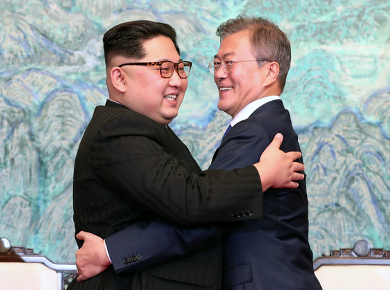 In this file photo, President Moon Jae-in, right, and North Korean leader Kim Jong-un hug each other after signing a joint declaration of their first summit at Panmunjom on April 27, 2018. [PRESIDENTIAL PRESS CORPS]