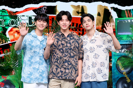 Even of Day, a subunit of rock band DAY6, poses for photos during an online showcase held on Monday for its second EP ″Right Through Me.″ [JYP ENTERTAINMENT]