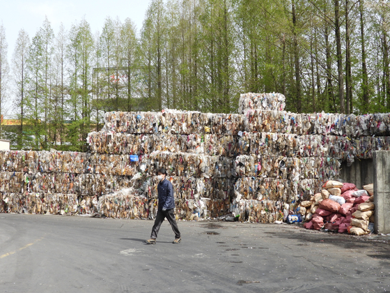Plastic waste piled up in a recycling center in Gimpo. [KANG CHAN-SU]