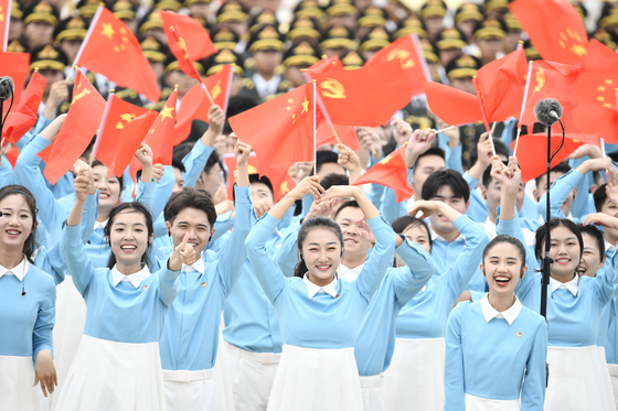 Young Chinese people celebrate the centenary of the Communist Party of China at Tiananmen Square in Beijing on July 1. [XINHUA/YONHAP]