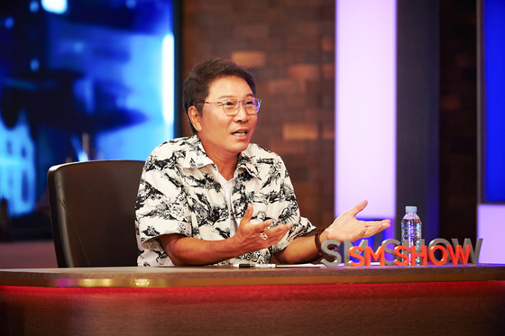 """Lee Soo-man, chief producer of SM Entertainment, presents the company's newly-launched projects in a video entitled """"SM Congress 2021,"""" uploaded Tuesday morning on SM Entertainment's official YouTube channel. [SM ENTERTAINMENT]"""