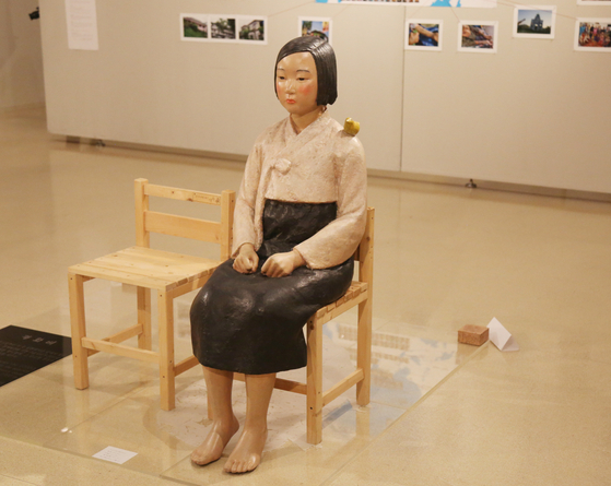 """A ″comfort woman"""" statue representing the victims of the Japanese military's wartime sexual slavery is displayed in an exhibition at the Citizen's Gallery Sakae in Nagoya, central Japan, Tuesday, for the first time in two years. It was previously displayed at the Aichi Triennale in Nagoya in 2019, while similar exhibitions are currently facing trouble opening in Tokyo and Osaka. [YONHAP]"""