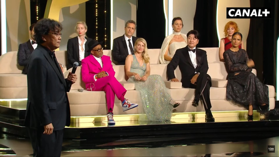 Director Bong, left, speaks on stage during the opening ceremony of the 74th Cannes Film Festival, with Song and other members of the Cannes' jury. [CANAL PLUS]