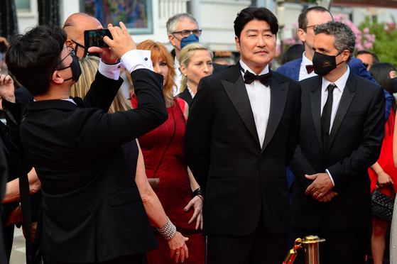 Jury member and ″Parasite″ star Song Kang-ho arrives for the opening ceremony of the 74th Cannes Film Festival, in Cannes, France. [EPA/YONHAP]