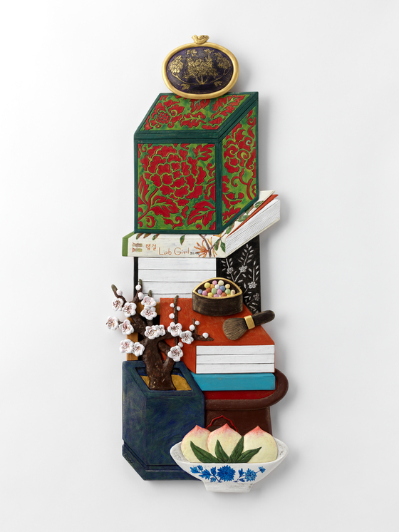 """A work by artist Lee Ji Sook, titled """"Wealth and Glory-Plum blossom and Lab girl."""" [PARK SANG-MOON]"""