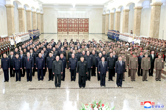 North Korean leader Kim Jong-un, center, pays tribute to his grandfather and regime founder Kim Il Sung alongside high-ranking Workers' Party members and military officials on the 27th anniversary of his death at the Kumsusan Palace of the Sun in Pyongyang on Thursday. [KCNA]