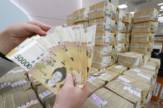 Stacks of 50,000 won notes at Hana Bank in Myeong-dong, Seoul. The government said it has collected 43.6 trillion won more taxes in the first five months of 2021 compared to the same period thanks to rising real estate prices, bullish stock market and robust export. [YONHAP]