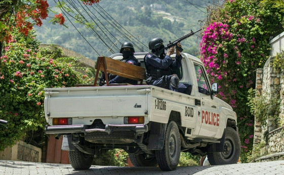 Police patrol outside the Embassy of Taiwan in Port-au-Prince, Haiti on July 9, after 11 suspected assassins of Haitian President Jovenel Moise broke into its embassy in an attempt to flee but were later apprehended by police. [VALERIE BAERISWYL/AFP]