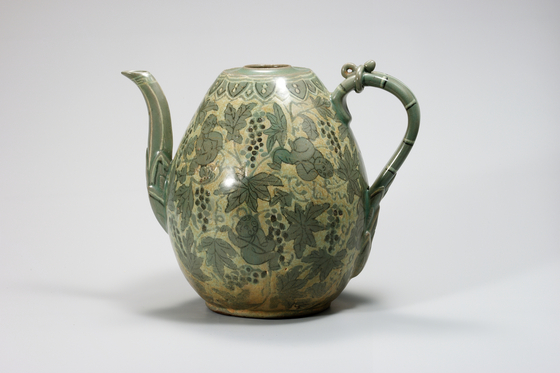 ″Celadon ware with Grape and Child Design,″ from Goryeo Dynasty. [NATIONAL MUSEUM OF KOREA]