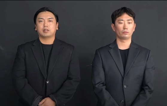 Comedian Kwak Beom, left, and comedian Lee Chang-ho are the real men behind Mad Monster members Tan and J.Ho. [SCREEN CAPTURE]