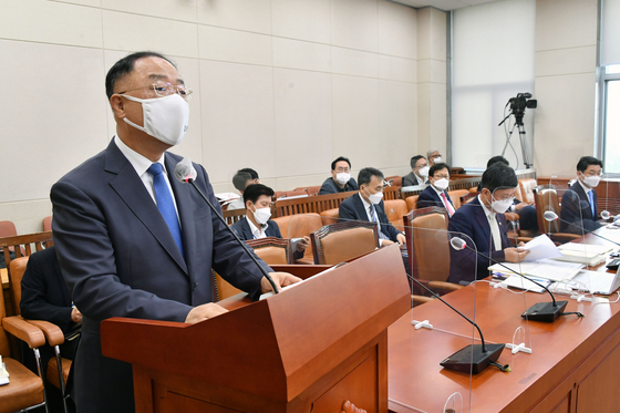 Finance Minister Hong Nam-ki speaks at the National Assembly's Strategy and Finance Committee on Tuesday.  [YONHAP]