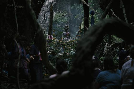 A statue of the rural god the townspeople worship. [SHOWBOX]