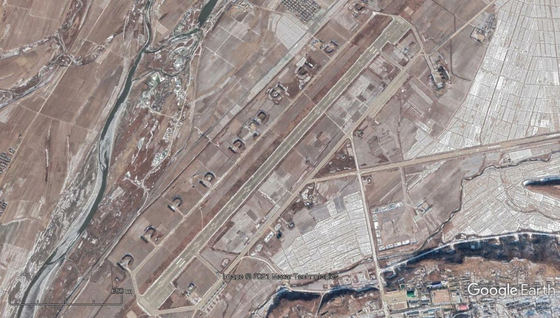 Satellite footage of Uiju Airport near the Sino-North Korean border, where delays in construction of planned sanitization and quarantine facilities reportedly resulted in the dismissal of Ri Pyong-chol from the North's Politburo Presidium. [GOOGLE EARTH]