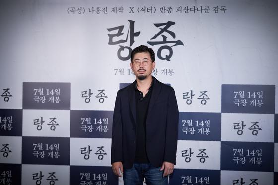 """Director-turned-producer Na Hong-jin poses at the press event of """"The Medium"""" at CGV Yongsan, central Seoul. [SHOWBOX]"""
