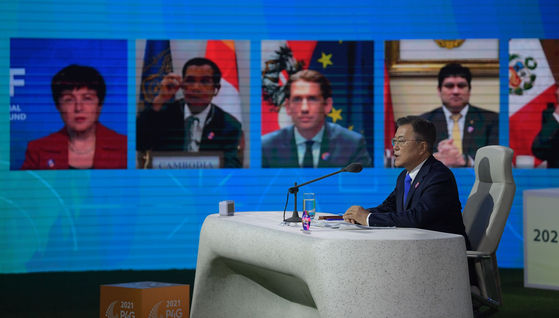 President Moon Jae-in speaks during the virtual 2021 P4G Seoul Summit at Dongdaemun Design Plaza on May 31. [JOINT PRESS CORPS]