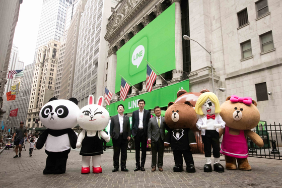 Executives of Line, a messaging affiliate of Naver, celebrate the unit's listing in New York on July 14, 2016. The stock was delisted last December, following the creation of a holdings unit between Naver and SoftBank. [LINE]