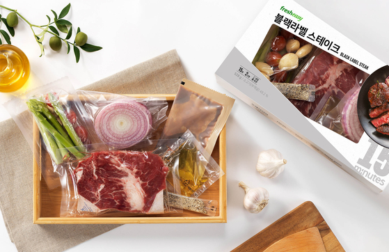 A steak meal kit sold by Fresh Easy. The kit includes a cut of beef, asparagus, garlic, red onions, steak sauce, olive oil and herb salt. [FRESH EASY]