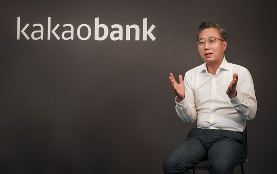 KakaoBank CEO Yun Ho-young talks during an online press briefing held Tuesday, ahead of its planned listing on the Korea Exchange next month. [KAKAOBANK]