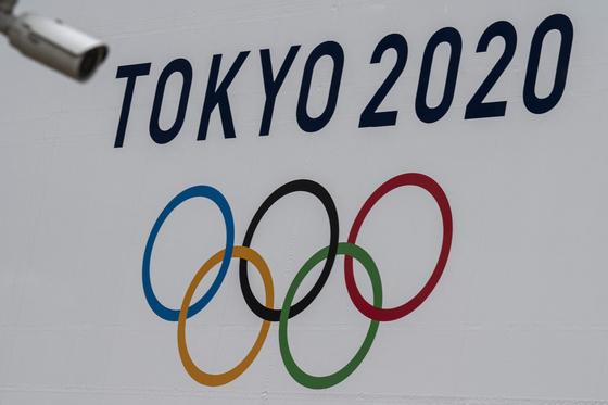 The Tokyo 2020 Olympics Games banner is displayed on a wall Tokyo in April. [AFP/YONHAP]