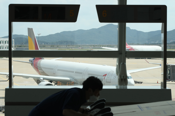 An Asiana Airlines plane is parked at Incheon International Airport on July 14. [YONHAP]