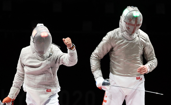 Kim Jung-hwan reacts after winning a point against Sandro Bazadze of Georgia in the men's sabre bronze medal match at Makuhari Messe Hall in Chiba, Japan on Saturday. [NEWS1]