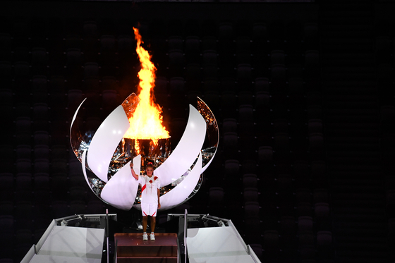 The Tokyo Olympic Flame was finally lit by tennis star Naomi Osaka, Friday, July 23. [JOINT PRESS CORPS]