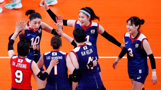 The Korean volleyball team celebrate after scoring a point in the women's preliminary round pool A volleyball match between Brazil and Korea during the Tokyo 2020 Olympic Games at Ariake Arena in Tokyo on Sunday. [AFP/ YONHAP]
