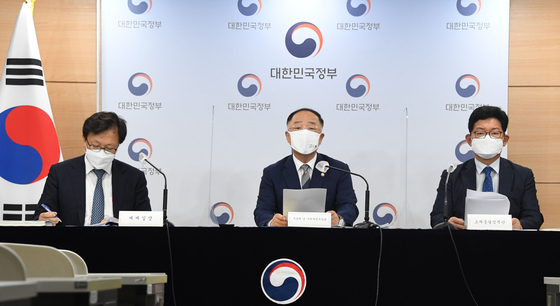 Finance Minister Hong Nam-ki attends a press briefing on tax reforms at the government complex in Sejong on Friday. [MINISTRY OF ECONOMY AND FINANCE]