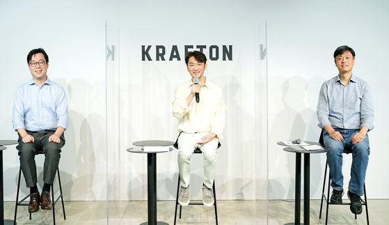 The three top managers of Krafton (from left) CFO Bae Dong-keun, CEO Kim Chang-han and Chairman Chag Byung-gyu sit down for an online press conference on Monday prior to the company's IPO scheduled for Aug. 10. [KRAFTON]