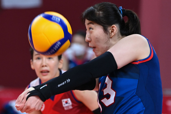 Park Jeong-ah hits the ball in the women's preliminary round pool A volleyball match between Brazil and Korea during the Tokyo 2020 Olympic Games at Ariake Arena in Tokyo on Sunday. [AFP/ YONHAP]