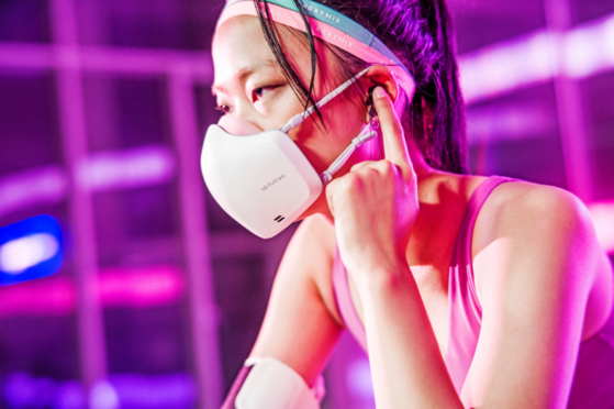 A model wears the second generation LG PuriCare Wearable Air Purifier. [LG ELECTRONICS]