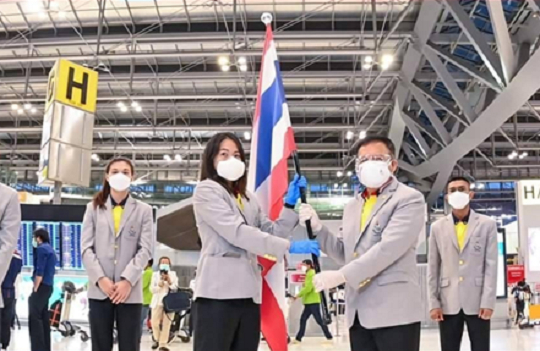 Athletes, coaches and staff of the Thailand Olympic team wear the second generation LG PuriCare Wearable Air Purifier as they depart for the Tokyo Olympics on July 23. [LG ELECTRONICS]