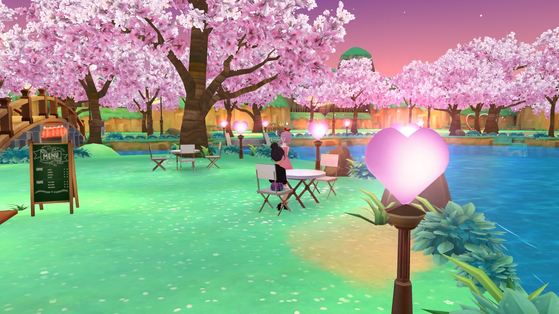 A user looks at cherry blossoms in a virtual park produced within Naver Z's Zepeto metaverse. [SCREEN CAPTURE]