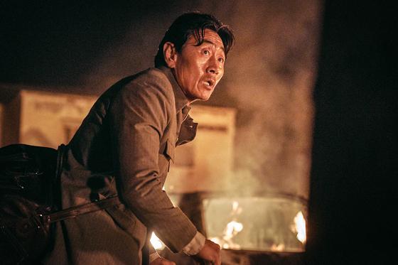 "Actor Huh Joon-ho portrays the ambassador of North Korea to Somalia, Rhim Yong-soo in ""Escape from Mogadishu."" [LOTTE ENTERTAINMENT]"