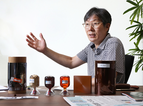 Kim Tae-lim, CEO of PI Advanced Materials, introduces a set of materials the company produces on July 20 at the company's office in central Seoul. [PARK SANG-MOON]
