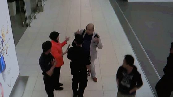 Kim Jong-nam requesting help from an airport receptionist after he was poisoned. [THE COOP]