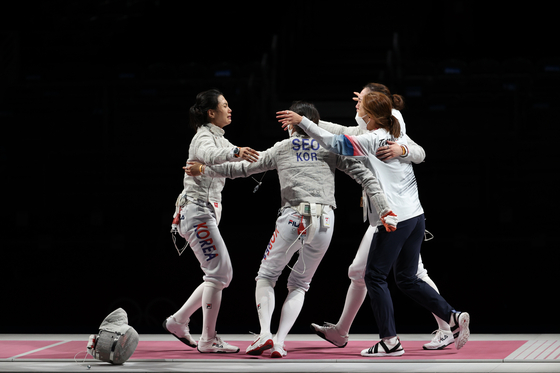 The Korean women's sabre team celebrate after winning the bronze medal against Italy at the Tokyo Olympics on Saturday at the Makuhari Messe Hall in Chiba, Japan. [JOINT PRESS CORPS]