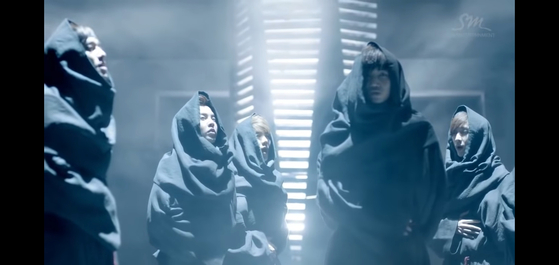 """Exo's debut music video """"Mama"""" (2012) shows members wearing robes reminiscent of """"medieval friars"""" according to Chammah J. Kaunda, a professor of theology at Yonsei University. [SCREEN CAPTURE]"""