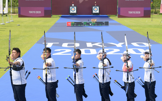 From left, Oh Jin-hyek, Kim Woo-jin, Kim Je-deok, Jang Min-hee, Kang Chae-young and An San pose for a picture during practice on June 28 at Jincheon National Training Center in Jincheon, North Chungcheong where a special set was made to resemble Yumenoshima Park Archery Field in Tokyo. [JOONGANG ILBO]