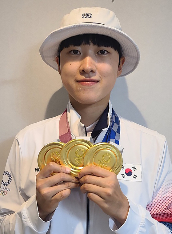 Archer An San celebrates her three gold medals won at the 2020 Tokyo Olympics. [YONHAP]