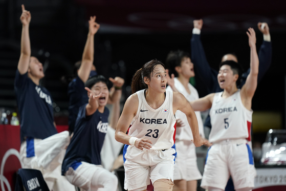 Kim Dan-bi turns back up court as teammates celebrate her scoring during a women's preliminary round basketball game against Serbia at the 2020 Summer Olympics on Sunday in Saitama, Japan. [AP/YONHAP]
