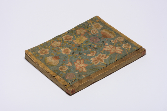 The embroidered silk cover of the Sutra of the Wise and the Foolish, a Buddhist scripture from the late Joseon period (1392-1910).  [SEOUL MUSEUM OF CRAFT ART]