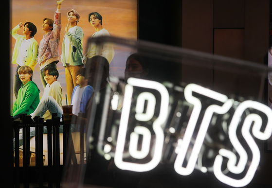 BTS advertisement at Lotte Duty Free in downtown Seoul. [YONHAP]