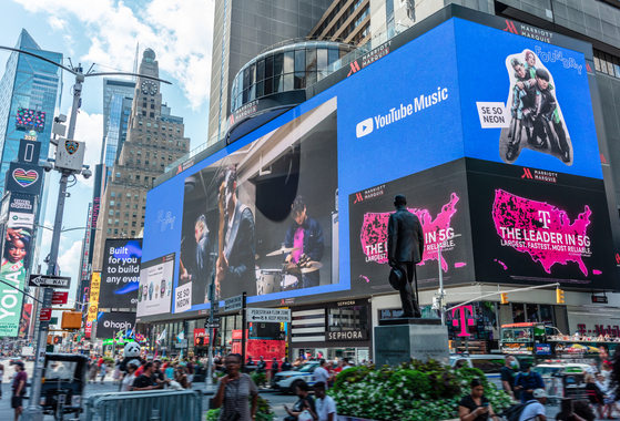 Indie band Se So Neon appears on a billboard in New York City as part of its participation in YouTube Music's Foundry program. [MAGIC STRAWBERRY SOUND]