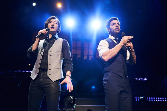 Musical actors Michael K. Lee, left, and Ramin Karimloo, during their duo concert in Korea in 2019. The two artists will hold a three-day concert together from Aug. 27 at the Goyang Aram Nuri Arts Center in Gyeonggi. [LIMAH PRODUCTIONS]