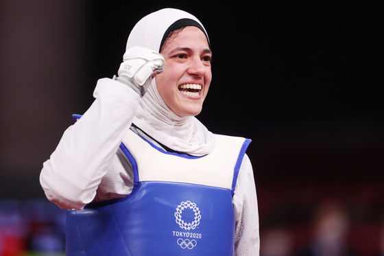 Hedaya Wahba of Egypt celebrates after defeating Paige McPherson of the United States in their bout during the Women's -67kg Bronze Medal Contest at the Tokyo 2020 Olympic Games at the Makuhari Messe convention center in Chiba, Japan, on July 26. [YONHAP]