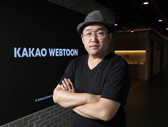 Park Jeong-seo, the CEO of Kakao Webtoon Studio, poses for photos after an interview with the Korea JoongAng Daily at the company's office in Pangyo, Gyeonggi, on Aug. 11. [PARK SANG-MOON]